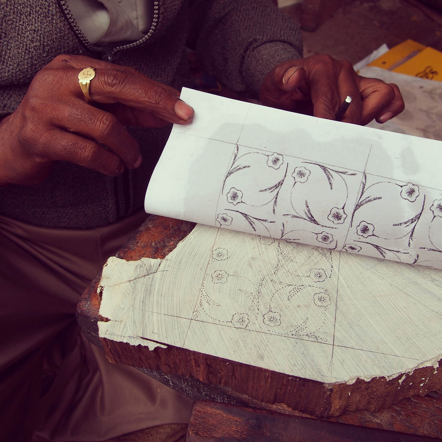 1.At the wood engraving workshop, a craftsman's hand transferring the design to the wood block