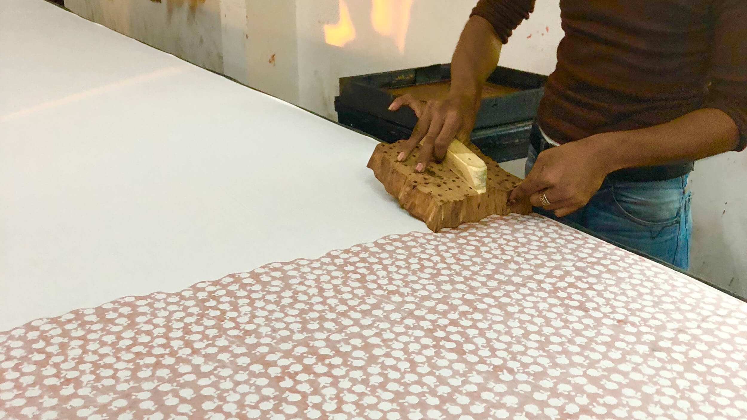 Hand of craftsman who is printing Hanauta pattern
