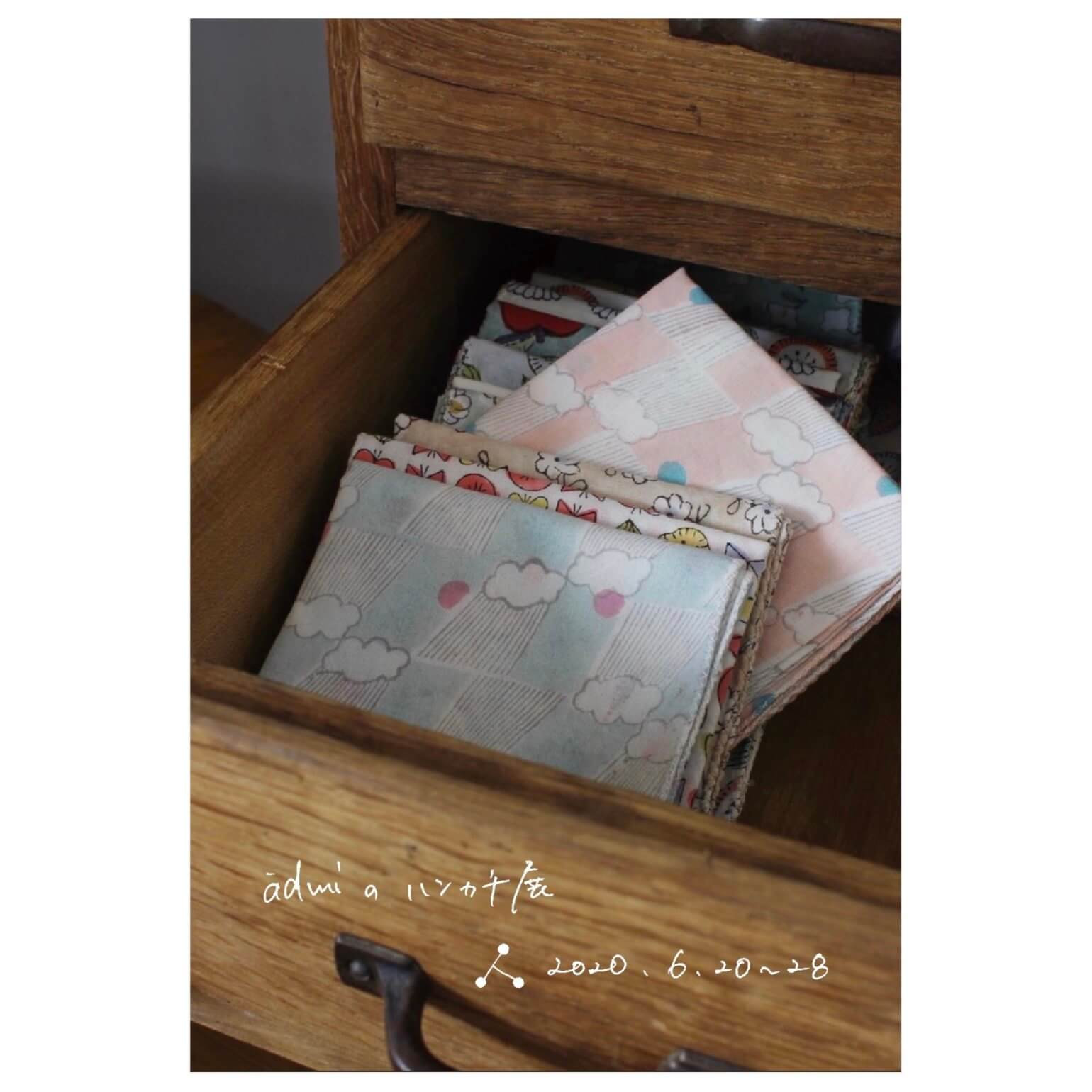 A variety of admi handkerchiefs in a wooden drawer